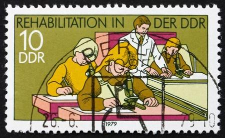 ddr: DDR - CIRCA 1979: a stamp printed in DDR shows Hospital Classroom, Rehabilitation in DDR, circa 1979 Editorial