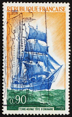 FRANCE - CIRCA 1972: a stamp printed in the France shows Newfoundlander Ship Cote d'Emeraude, Barquentine Ship, Fishing Vessel, circa 1972