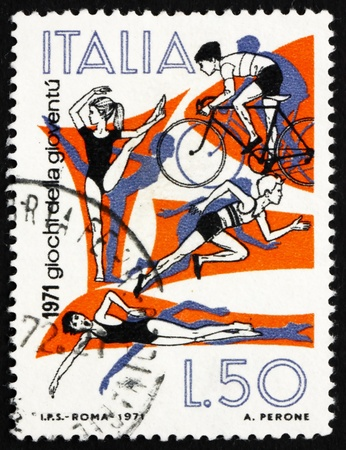 ITALY - CIRCA 1971: a stamp printed in the Italy shows Gymnastics, Cycling, Track and Swimming, Youth Games, circa 1971