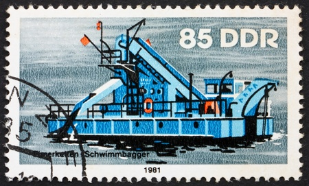 dredger: GDR - CIRCA 1981: a stamp printed in GDR shows Bucket Dredger, River Boat, circa 1981 Editorial