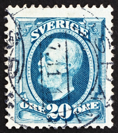 SWEDEN - CIRCA 1891: a stamp printed in the Sweden shows King Oscar II, King of Sweden, circa 1891 Stock Photo - 13824447