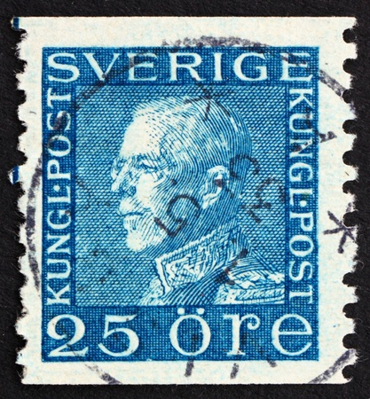 SWEDEN - CIRCA 1925: a stamp printed in the Sweden shows King Gustaf V, King of Sweden, circa 1925 Stock Photo - 13824451