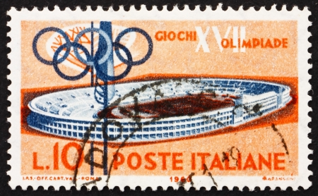 ITALY - CIRCA 1960: a stamp printed in the Italy shows Olympic Stadium, 17th Olympic Games, Rome, circa 1960 Stock Photo - 13847311