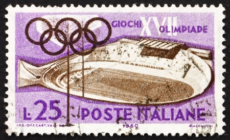 ITALY - CIRCA 1960: a stamp printed in the Italy shows Velodrome, 17th Olympic Games, Rome, circa 1960 Stock Photo - 13847319