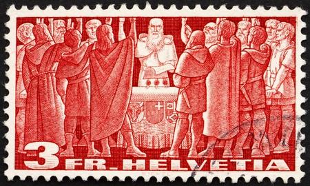 pacto: SUIZA - CIRCA 1938: un sello impreso en Suiza muestra el primer Pacto Federal, Federal Carta de 1291, el nacimiento de la Antigua Confederaci�n Suiza, alrededor del a�o 1938 Editorial