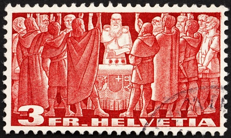 confederacy: SWITZERLAND - CIRCA 1938: a stamp printed in the Switzerland shows First Federal Pact, Federal Charter, 1291, the Birth of the Old Swiss Confederacy, circa 1938 Editorial