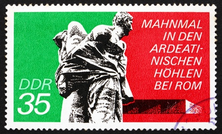 massacre: GDR - CIRCA 1974: a stamp printed in GDR shows Bound Guerrillas, Ardeatine Caves, Rome, Ardeatine massacre, circa 1974
