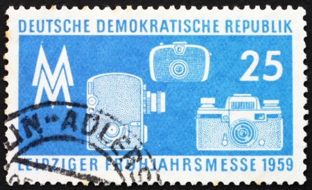 GDR - CIRCA 1959: a stamp printed in GDR shows Photographic Equipment, Leipzig Spring Fair, circa 1959