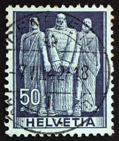 confederacy: SWITZERLAND - CIRCA 1941: a stamp printed in the Switzerland shows The Three Swiss, Oath on Rutli Mountain, 1291, the Birth of the Old Swiss Confederacy, circa 1941