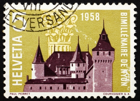 SWITZERLAND - CIRCA 1958: a stamp printed in the Switzerland shows Nyon Castle and Corinthian Capital, 2000th Anniversary of Nyon, circa 1958 Stock Photo - 13860917