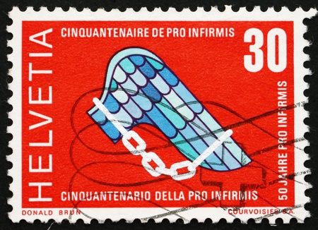 foundation problems: SWITZERLAND - CIRCA 1970: a stamp printed in the Switzerland shows Pro Infirmis Emblem, 50th Anniversary of the Pro Infirmis Foundation, Help Disabled, circa 1970