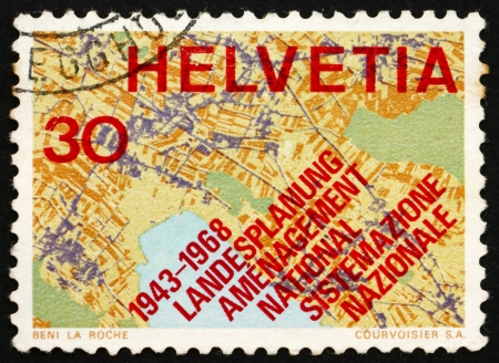 SWITZERLAND - CIRCA 1968: a stamp printed in the Switzerland shows Map Showing Systematic Planning, 25th Anniversary of the Swiss Society for Territorial Planning, circa 1968