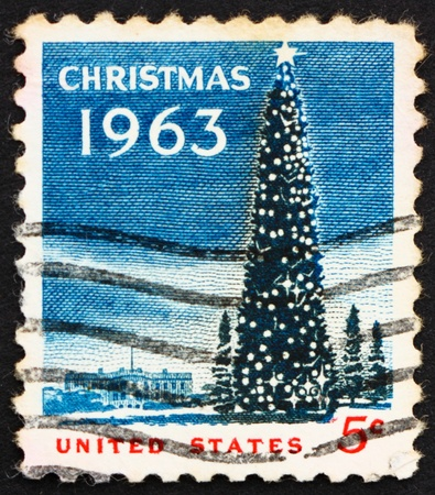 UNITED STATES OF AMERICA - CIRCA 1963: a stamp printed in the USA shows National Christmas Tree and White House, Christmas, circa 1963