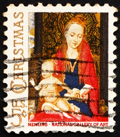memling: UNITED STATES OF AMERICA - CIRCA 1966: a stamp printed in the USA shows Detail from Painting Madonna and Child with Angels by Hans Memling, Christmas, circa 1966 Editorial