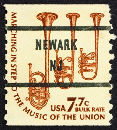 saxhorn: UNITED STATES OF AMERICA - CIRCA 1976: a stamp printed in the USA shows Saxhorns, musical instruments, circa 1976 Editorial