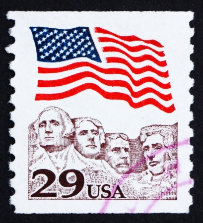 'mt rushmore': UNITED STATES OF AMERICA - CIRCA 1991: a stamp printed in the USA shows USA Flag over Mt. Rushmore, circa 1991