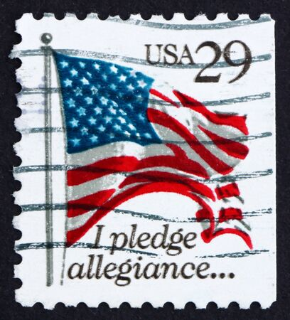 allegiance: UNITED STATES OF AMERICA - CIRCA 1992: a stamp printed in the USA shows USA Flag, Pledge of Allegiance, circa 1992