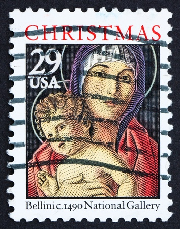 bellini: UNITED STATES OF AMERICA - CIRCA 1992: a stamp printed in the USA shows Detail from Painting Madonna and Child by Giovanni Bellini, Christmas, circa 1992
