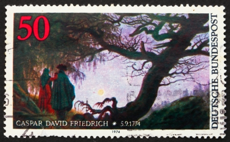 caspar: GERMANY - CIRCA 1974: a stamp printed in the Germany shows Man and Woman Looking at the Moon, by Caspar David Friedrich, circa 1974 Editorial