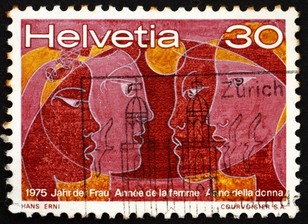SWITZERLAND - CIRCA 1975: a stamp printed in the Switzerland shows Women of Four Races, International Women�s Year 1975, circa 1975 Stock Photo - 14141662
