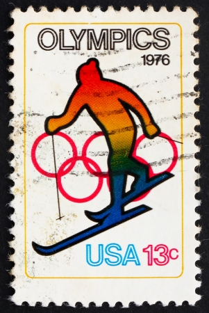 UNITED STATES OF AMERICA - CIRCA 1976: a stamp printed in the USA shows Skiing and Olympic Rings, 12th Winter Olympic Games, Innsbruck, Austria, circa 1976