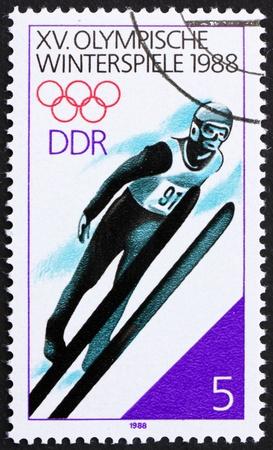 GDR - CIRCA 1988: a stamp printed in GDR shows Ski Jumping, 15th Winter Olympics, Calgary, Canada, circa 1988