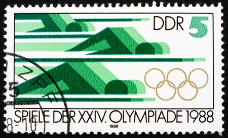 summer olympics: GDR - CIRCA 1988: a stamp printed in GDR shows Swimming, 24th Summer Olympics, Seoul, South Korea, circa 1988