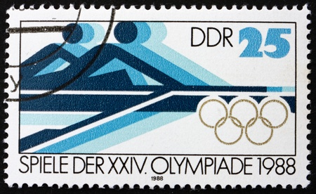 summer olympics: GDR - CIRCA 1988: a stamp printed in GDR shows Rowing, 24th Summer Olympics, Seoul, South Korea, circa 1988 Editorial