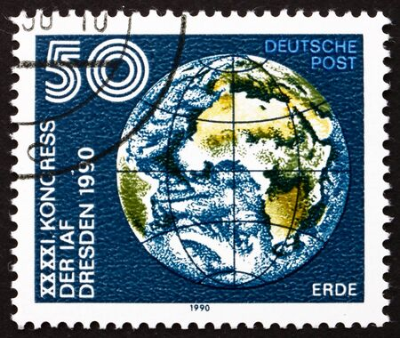 astronautics: GDR - CIRCA 1990: a stamp printed in GDR shows Earth Globe, 41st Congress of International Astronautics Federation, Dresden, circa 1990