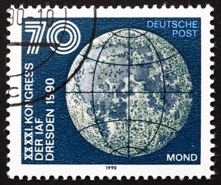 astronautics: GDR - CIRCA 1990: a stamp printed in GDR shows Moon, 41st Congress of International Astronautics Federation, Dresden, circa 1990