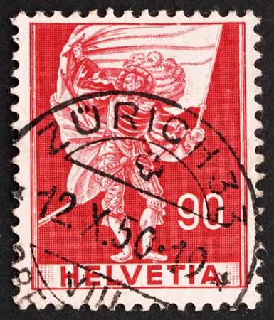 SWITZERLAND - CIRCA 1959: a stamp printed in the Switzerland shows Standard Bearer, circa 1959