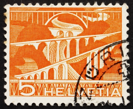 viaducts: SWITZERLAND - CIRCA 1949: a stamp printed in the Switzerland shows Viaducts, circa 1949