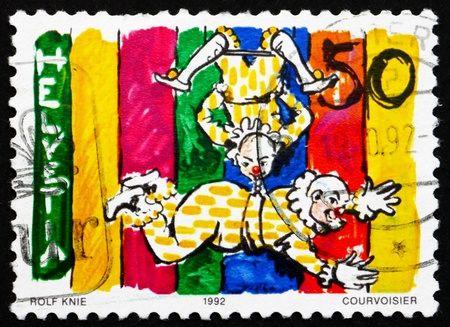trapeze: SWITZERLAND - CIRCA 1992: a stamp printed in the Switzerland shows Clowns on Trapeze, World of the Circus, circa 1992