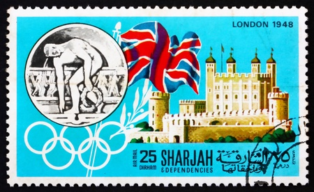 SHARJAH - CIRCA 1968: a stamp printed in the Sharjah UAE shows Olympic Games London 1948, Great Britain, History of Olympic Games, circa 1968 Stock Photo - 14146316