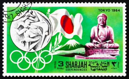 SHARJAH - CIRCA 1968: a stamp printed in the Sharjah UAE shows Olympic Games Tokyo 1964, Japan, History of Olympic Games, circa 1968 Stock Photo - 14146317