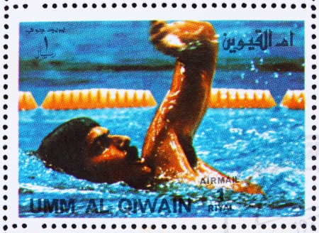 UMM AL-QUWAIN - CIRCA 1972: a stamp printed in the Umm al-Quwain shows Mark Spitz, USA, Winner of the Summer Olympics Munich 1972, circa 1972 Stock Photo - 14146353