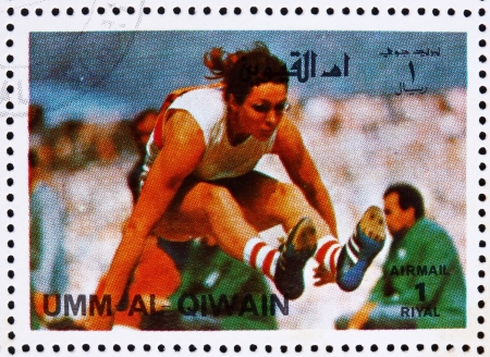 summer olympics: UMM AL-QUWAIN - CIRCA 1972: a stamp printed in the Umm al-Quwain shows Long Jump, Athletics, Summer Olympics, Munich 1972, circa 1972 Editorial