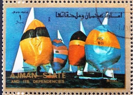 summer olympics: AJMAN - CIRCA 1973: a stamp printed in the Ajman shows Sailing, Summer Olympics, circa 1973