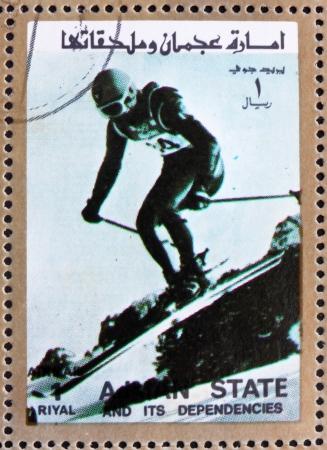 AJMAN - CIRCA 1973: a stamp printed in the Ajman shows Downhill Skiing, Alpine Skiing, Winter Olympics, circa 1973
