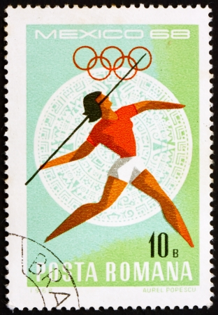 ROMANIA - CIRCA 1968: a stamp printed in the Romania shows Javelin, Women's, Summer Olympic sports, Mexico 68, circa 1968 Stock Photo - 14200473