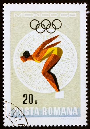 ROMANIA - CIRCA 1968: a stamp printed in the Romania shows Woman Diver, Summer Olympic sports, Mexico 68, circa 1968 Stock Photo - 14200471