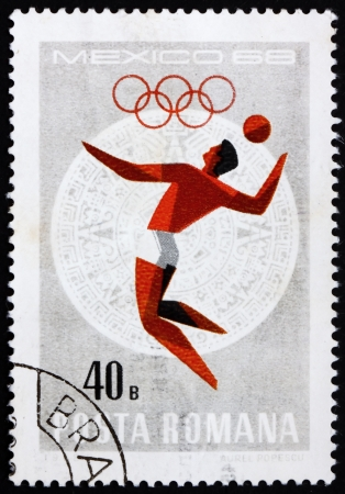 ROMANIA - CIRCA 1968: a stamp printed in the Romania shows Volleyball, Summer Olympic sports, Mexico 68, circa 1968 Stock Photo - 14200466