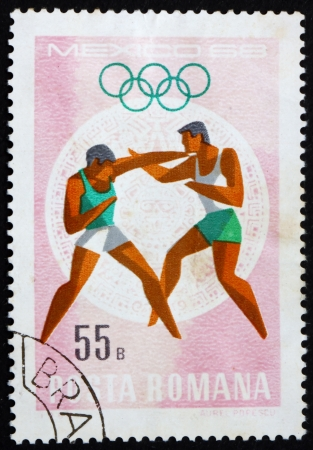 ROMANIA - CIRCA 1968: a stamp printed in the Romania shows Boxing, Summer Olympic sports, Mexico 68, circa 1968 Stock Photo - 14200470