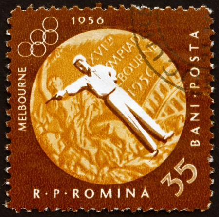 ROMANIA - CIRCA 1961: a stamp printed in the Romania shows Pistol Shooting, Summer Olympic sports, Melbourne 56, circa 1961 Stock Photo - 14200465