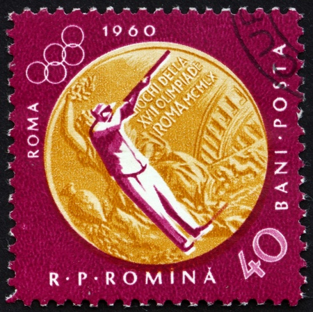 ROMANIA - CIRCA 1961: a stamp printed in the Romania shows Sharpshooting, Summer Olympic sports, Rome 60, circa 1961 Stock Photo - 14200468