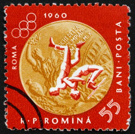 ROMANIA - CIRCA 1961: a stamp printed in the Romania shows Wrestling, Summer Olympic sports, Roma 60, circa 1961 Stock Photo - 14200472