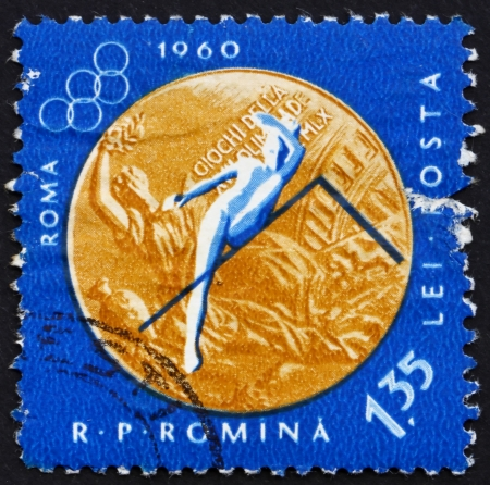 ROMANIA - CIRCA 1961: a stamp printed in the Romania shows Woman�s High Jump, Summer Olympic sports, Roma 60, circa 1961 Stock Photo - 14200469