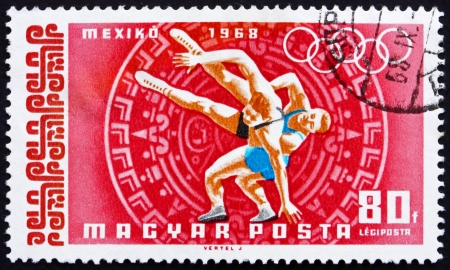 HUNGARY - CIRCA 1968: a stamp printed in the Hungary shows Wrestling, Summer Olympic sports, Mexico 68, circa 1968