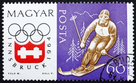 HUNGARY - CIRCA 1963: a stamp printed in the Hungary shows Downhill Skiing, Winter Olympic sports, Innsbruck 64, circa 1963