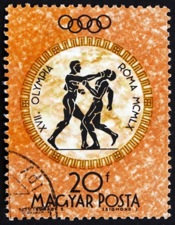 HUNGARY - CIRCA 1960: a stamp printed in the Hungary shows Boxers, Summer Olympic sports, Rome 60, circa 1960 Editorial